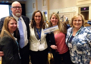 (L-R) Stacey Murphy, VP of Clinical Services at TMHCA; Anthony Fox, CEO of TMHCA; Cat Turpin, Key Account Manager at Qualifacts; Jenn Brinn, Digital Marketing Specialist at Qualifacts; Ellyn Wilbur, Executive Director of TAMHO
